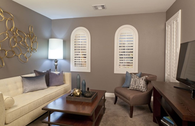 Las Vegas family room with arch plantation shutters.