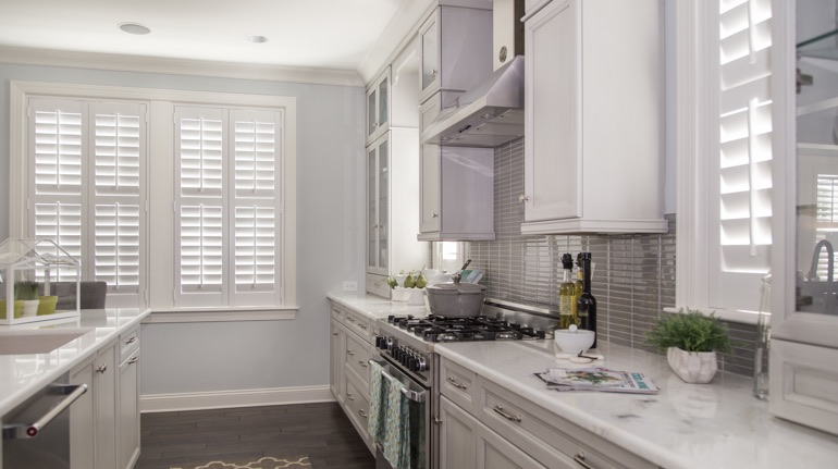 White shutters in Las Vegas kitchen with white cabinets.