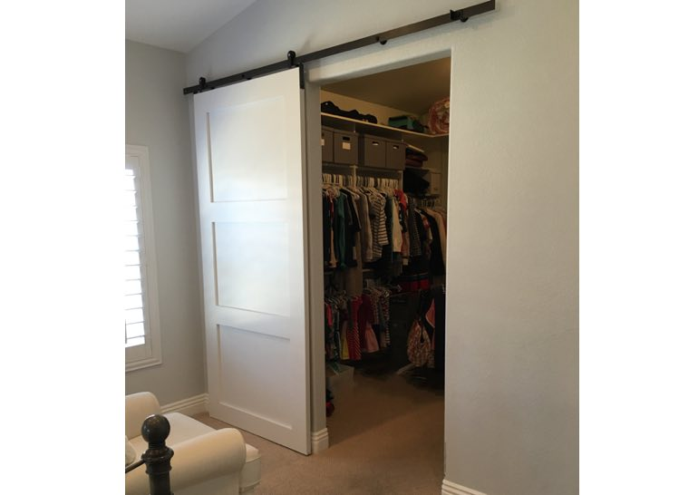 White barn door used as closet door 🚪
