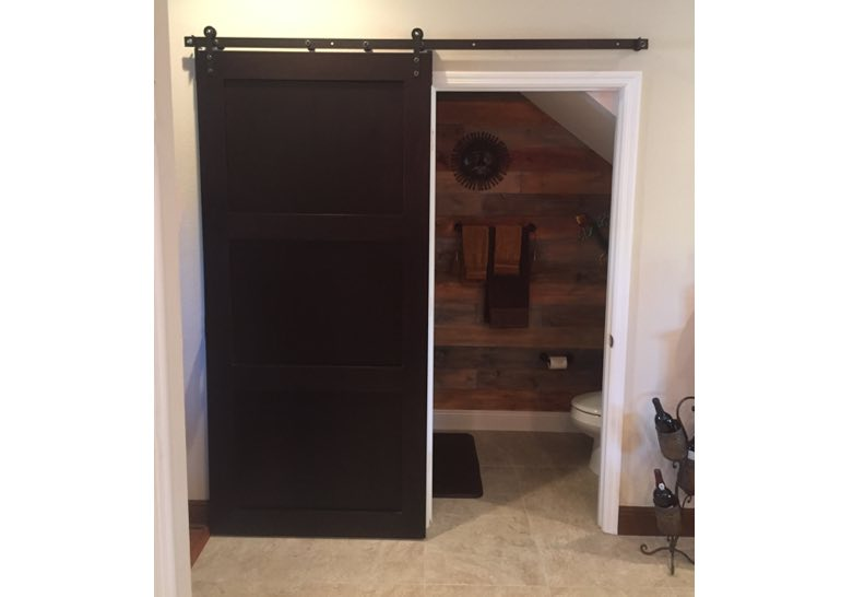 Brown bathroom sliding barn door 🚪