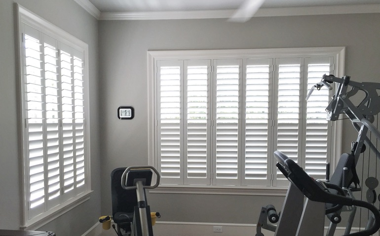 Las Vegas home gym with shuttered windows.