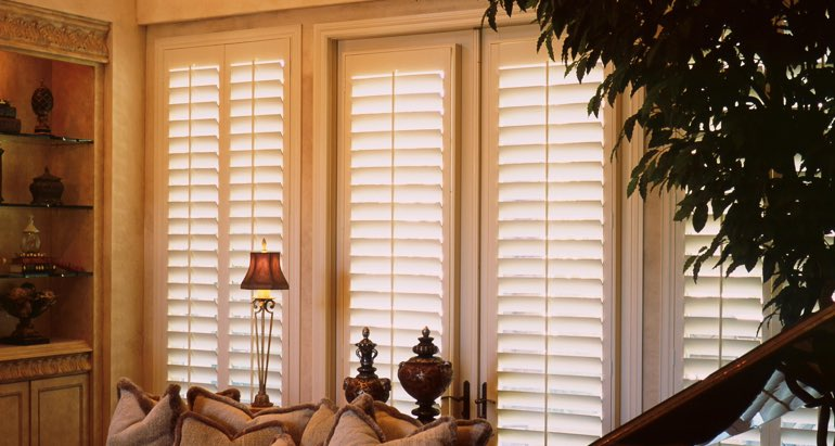 Plantation shutters on french door and window in Las Vegas lounge