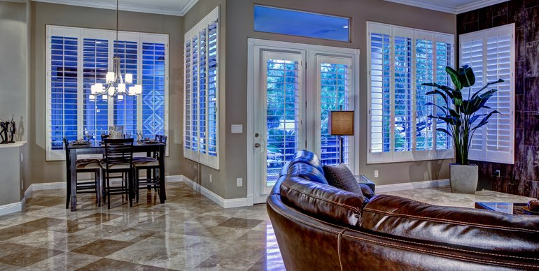 Las Vegas great room with classic shutters and modern lighting.