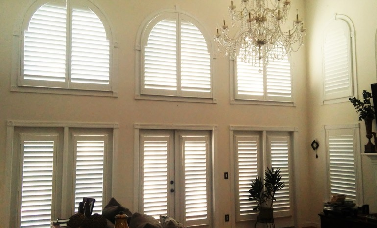 High Ceiling Window Treatments Television Room In Two Story Las Vegas House With Plantation Shutters On Arch Windows