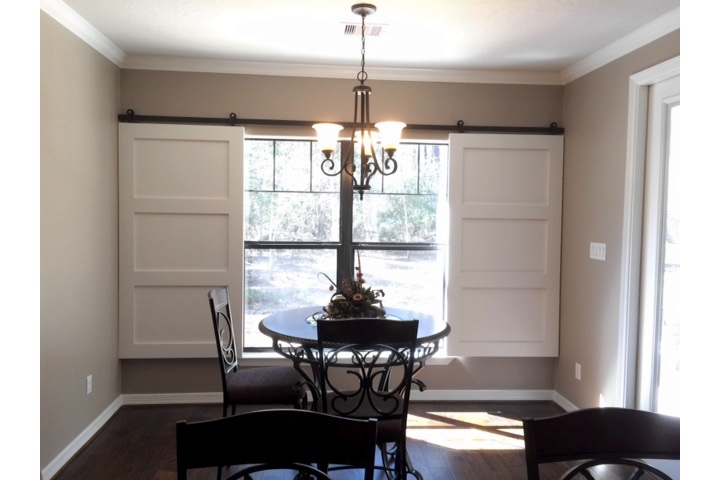 Las Vegas dining room with white barn door shutters.