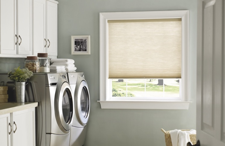 Las Vegas laundry room with tan window shades.