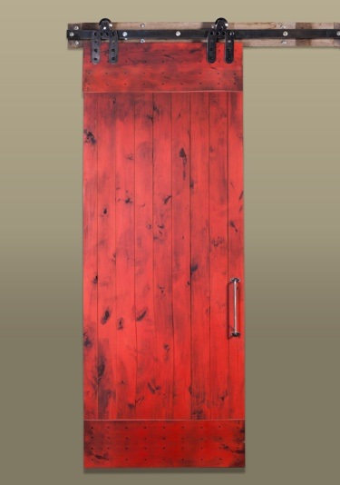 Red sliding barn door in the rustic style