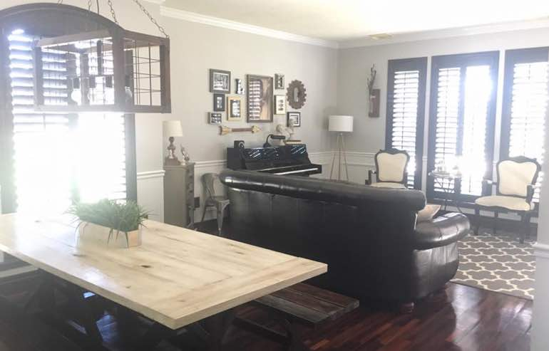 Natural Wood shutters in family room windows by Sunburst Shutters Las Vegas.