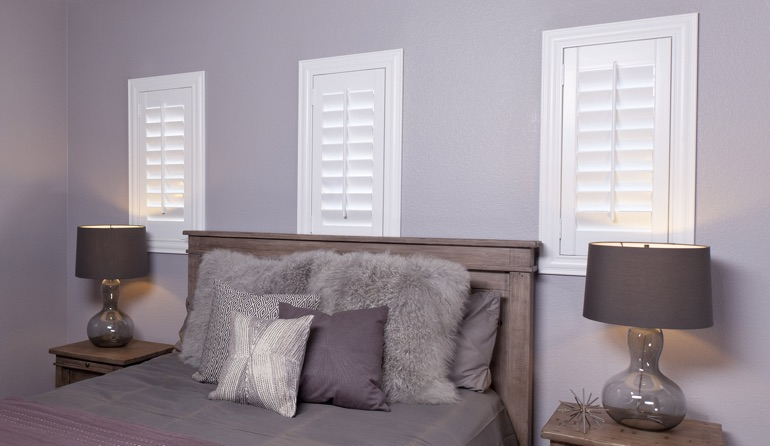 Studio plantation shutters in Las Vegas bedroom windows.