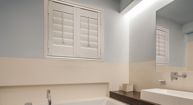 Plantation waterproof shutters in Las Vegas bathroom.