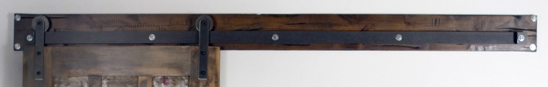 Dark brown track header for sliding barn door shutters