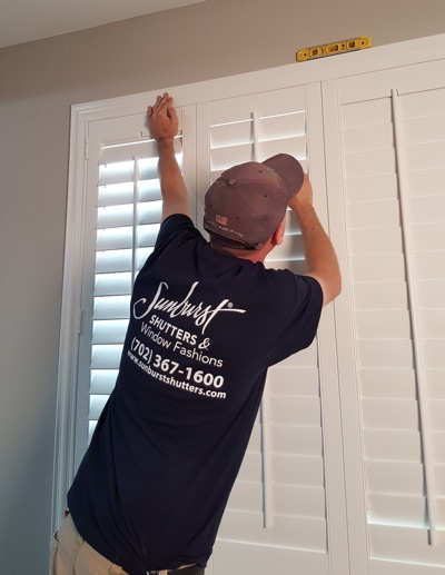 Shutter installation in Las Vegas bedroom.