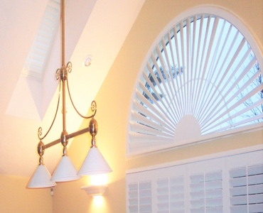 Las Vegas arched eyebrow window with plantation shutter
