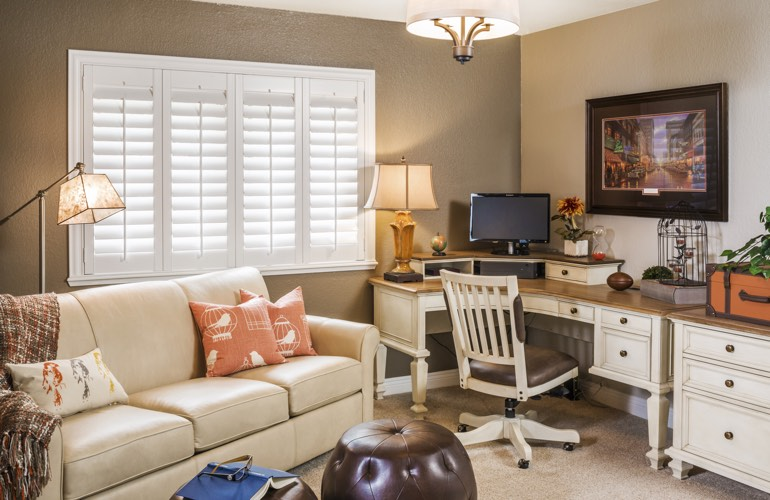 Las Vegas home office with plantation window shutters.