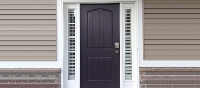 Entry Door Sidelight Shutters Next To Black Door In Las Vegas, NV