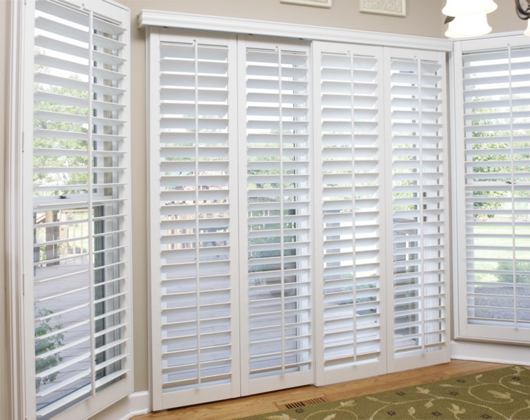 Sliding glass door with white shutters Las Vegas