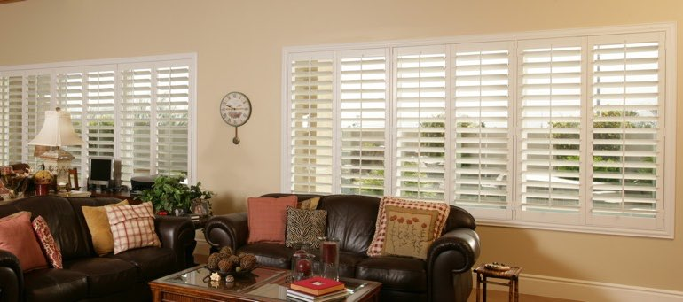 Wide window with white shutters in Las Vegas living room